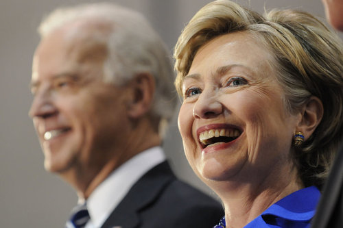 Democratic vice presidential candidate U.S. Senator Joe Biden (D-DE) and U.S. Sen. Hillary Clinton (D-NY) smile at a rally in support of Democratic