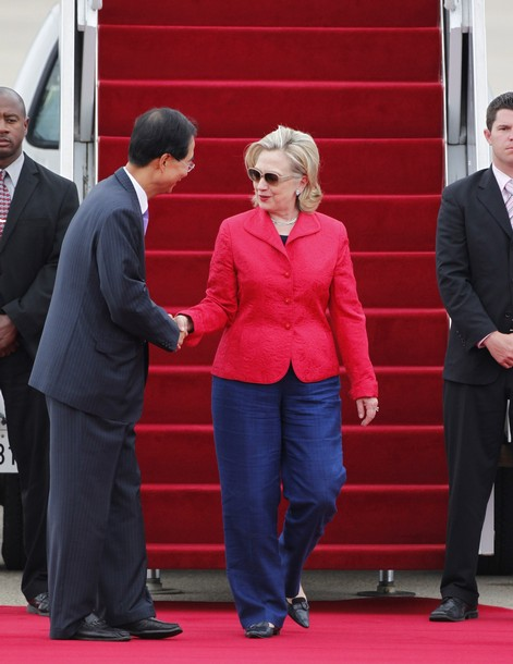 U.S. Secretary of State Clinton is greeted by Han, South Korean ambassador to the U.S., upon her arrival at a military airport in Seongnam