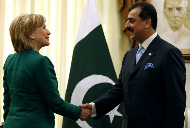 Pakistan's Prime Minister Gilani shakes hands with U.S. Secretary of State Clinton at his residence in Islamabad