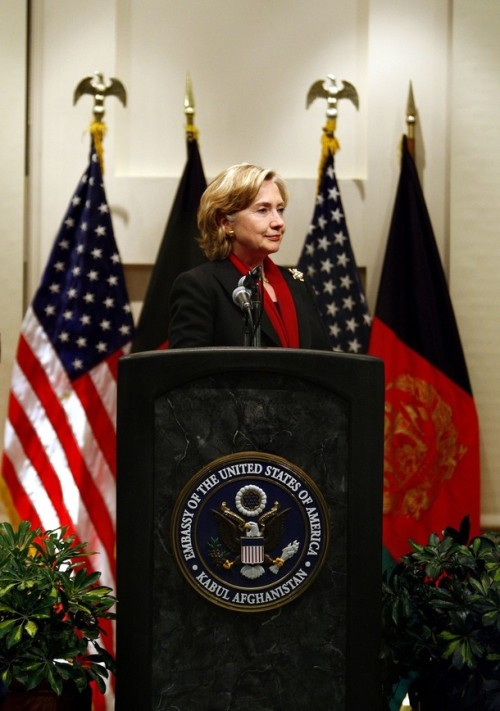 U.S. State Secretary Hillary Clinton listens during a news conference at the U.S. embassy in Kabul