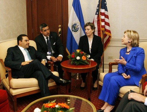 U.S. Secretary of State Hillary Clinton talks with El Salvador's President Elias Antonio Saca during a private meeting in a hotel in San Salvador