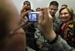 U.S. State Secretary Hillary Clinton poses for a picture with International troops at Kabul airport before he departure from Afghanistan
