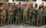 International troops listen to a speech by U.S. State Secretary Hillary Clinton during a meeting at Kabulairport
