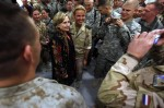 U.S. State Secretary Hillary Clinton poses for a picture with a Dutch female soldier at Kabul airport before leaving Afghanistan