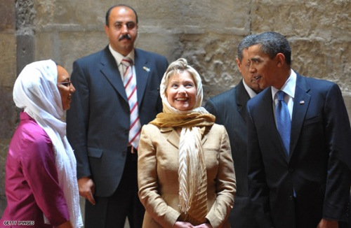 US President Barack Obama (R) and US Secretary of State Hillary Clinton (2R) listen to an explanation by an Egyptian-American art historian (L) as they tour the Sultan Hassan Mosque in Cairo, June 4, 2009. Obama took a tour of the medieval mosque in the heart of old Cairo on a trip aimed at repairing rifts with the Muslim world. AFP PHOTO/MANDEL NGAN (Photo credit should read MANDEL NGAN/AFP/Getty Images)