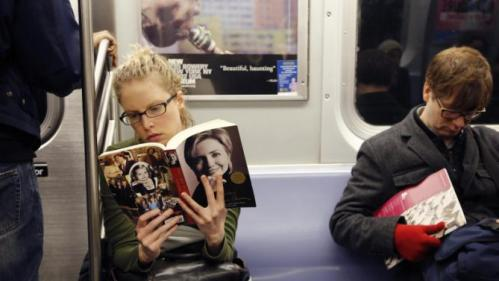 "Linda Leseman reads ""Living History,"" a memoir by Hillary Rodham Clinton, while riding the subway, Tuesday, March 1, 2016, in New York. Democratic presidential candidate Hillary Clinton enters a series of Super Tuesday contests poised to extend her lead over Democratic rival Bernie Sanders, who risks a major setback for his insurgent campaign with a poor showing in primaries and caucuses across the nation. (AP Photo/Mark Lennihan)"